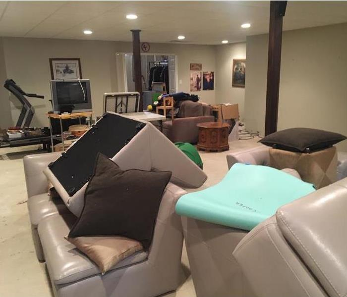 Large family room with furniture piled in center