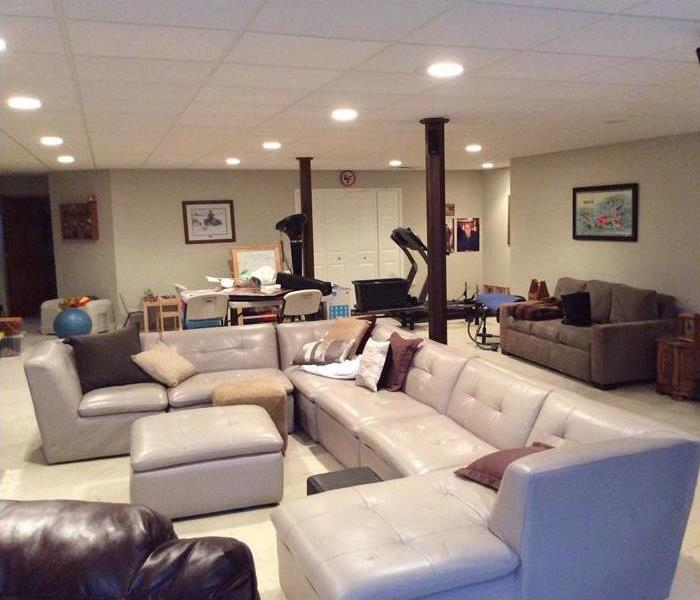 Large family room with furniture neatly arranged