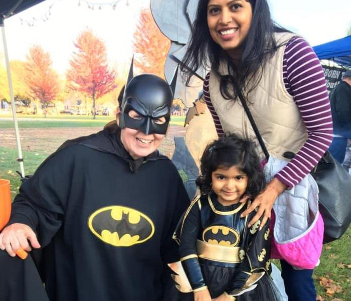 Little girl and Adult in Batman costumes