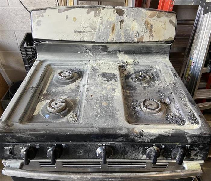 Fire damaged stove top