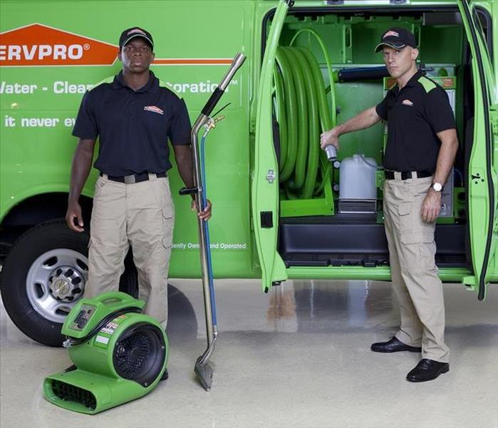 Two SERVPRO teams with water extracting equipment