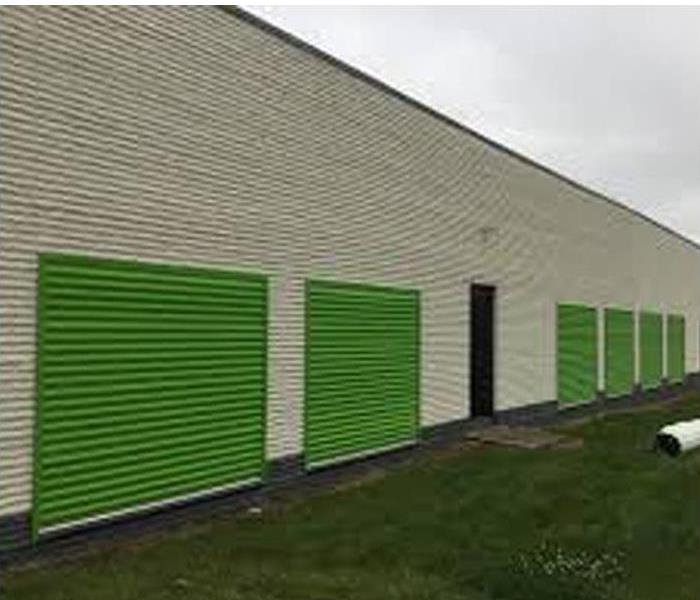 Exterior shot of storage facility with florescent green doors