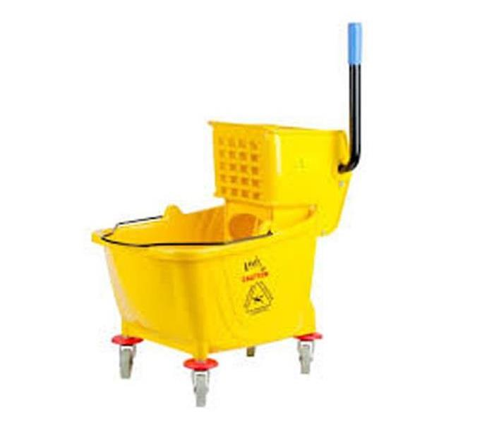 Yellow commercial mop bucket